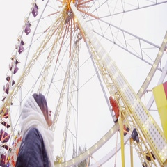 Beautiful brunette girl looking at observation wheel Stock Footage