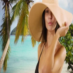 Young white girl in a sun hat poses for a portrait on a Caribbean beach Stock Footage