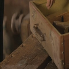 Male worker puts things in order in his workshop after work , 4K Stock Footage