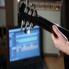 Guitarist record guitar session Stock Footage