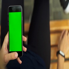 Woman sitting on a bench , checking results on fitness trackers. Green screen Stock Footage