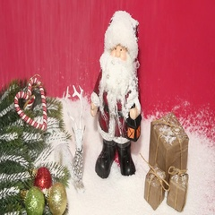 Santa claus and gift box under snow Stock Footage