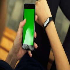 Young woman holding smartphone on her hands and wearing fitness trackers to Stock Footage