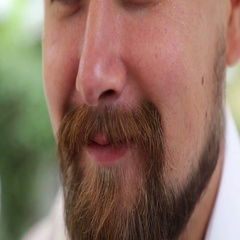Man with foam on nose and moustache drinking beer Stock Footage