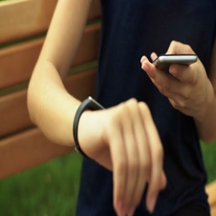 Young lady in black t-shirt sitting on a bench and checking results of her Stock Footage