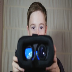 A young boy giving a virtual reality headset Stock Footage