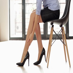Woman in high heels massaging her tired legs, close up HD Stock Footage
