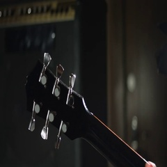 Guitarist tune electric guitar Stock Footage