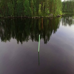 Green and red lateral seamarks at a lake, aerial orbit shot Stock Footage