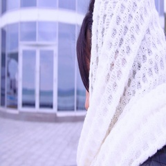 Woman in scarf looks in the mirror Stock Footage