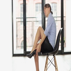 Woman taking off her high heels shoes and massaging her tired legs  HD Stock Footage