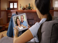 Young white woman talking to her parents via video chat Stock Footage