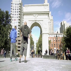 Tourists with backpack walking toward Washington Square Park arch summer day NYC Stock Footage