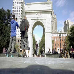 Tourist taking picture with smartphone of Washington Square Park arch NYC Stock Footage