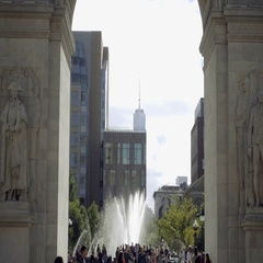 People in Washington Square Park, zooming out with Freedom Tower view NYC Stock Footage