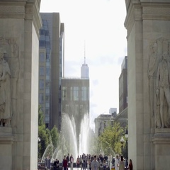 Crowded Washington Square Park with arch and Freedom Tower view - Tisch Fountain Stock Footage
