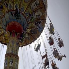 Children having fun on swing chair ride at amusement park Santa Cruz California Stock Footage