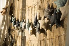 Interior walls of the old burlap hanging made of cloth with stars Stock Photos