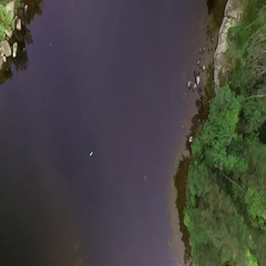 Aerial vertical shot, navigating above a strait sea lane between shoals at a Stock Footage
