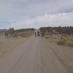 Off road 4x4 following motorcycle dusty desert road semi truck POV HD 033 Stock Footage