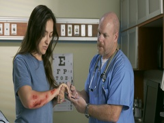 Male nurse takes notes from young woman about arm injury in emergency room 4K Stock Footage