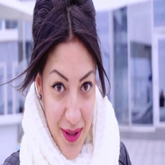 Portrait of young brunette woman looking to camera Stock Footage