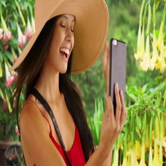 Young white girl poses for a selfie in the tropics Stock Footage