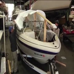 Pulling Tarp over Boat Stock Footage