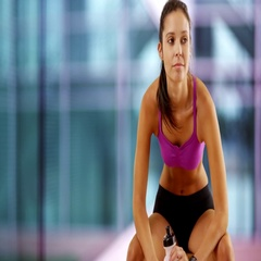 Young white girl sits down at the gym Stock Footage