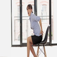 Young business woman with back pain HD Stock Footage