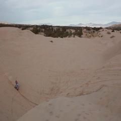Dirt Bike Jump Over Sand Dunes HD Stock Footage