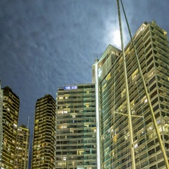 Tides: Hawaii, Moonrise over Building with Boats Stock Footage