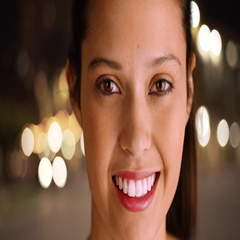 Smiling millennial Caucasian girl posing for a portrait in the city Stock Footage