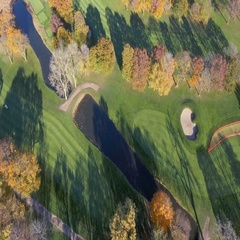 Aerial overhead shot above Golf Course in fall season Stock Footage