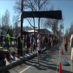 5k Road Race Runners Crossing the Finish Line Stock Footage