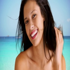 Happy Caucasian young girl at smiling with white teeth at the beach Stock Footage
