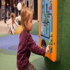 Little child girl play on indoors mall playground for children Stock Footage