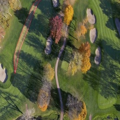 Flying above Golf Course in Fall Scenery Stock Footage