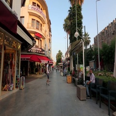 Footage of a street in Kusadasi with palm trees in Turkey Stock Footage