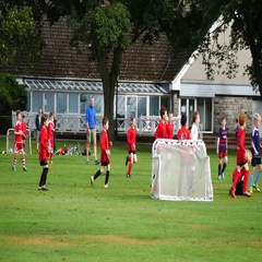 Young boys playing football soccer game in the park in Aberdeen Stock Footage
