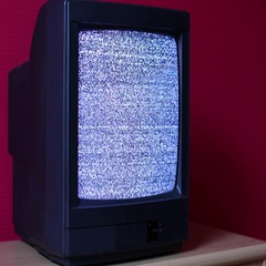 No signal just noise on an old TV in a dim room Stock Footage