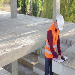 Building Engineer Does Measurements of the Building Stock Footage
