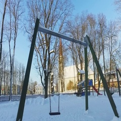 Walk along the city covered with snow. Kids playground. Sunny winter day. Stock Footage