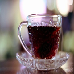 Black tea in a bag brewed in a glass cup Stock Footage