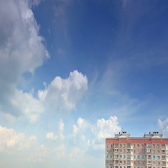 Movement of clouds over the forest, high-rise building, time-lapse Stock Footage