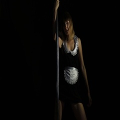 Hot young woman in sexy lingerie performs sensual pole dance. Go-go dancer Stock Footage