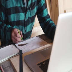 Carpenter work in his workshop with drawing equipment, paper, ruler, pencil and Stock Footage