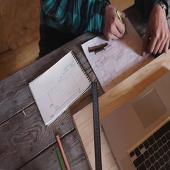 Woodworker work in his workshop with drawing equipment, paper, ruler, pencil and Stock Footage