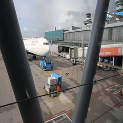 Pushback car pulling airplane at Schiphol airport Stock Footage