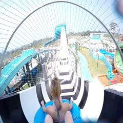 Slope down by water slide in water park. Fun travel inside of the multi color Stock Footage